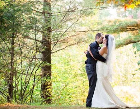wedding couple with fall foliage   Sterling Ridge Resort
