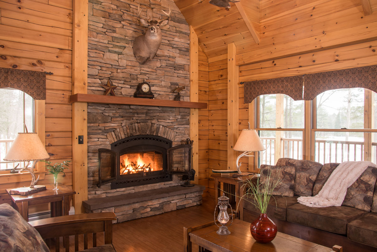field and stream cabin living area with fireplace | Sterling Ridge Resort