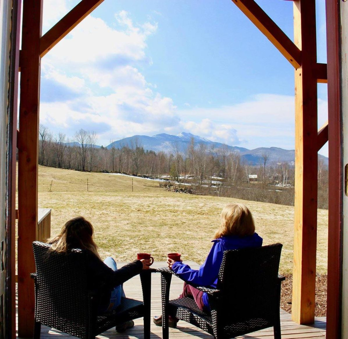 Two women having coffee with view of mt mansfield | sterling ridge resort