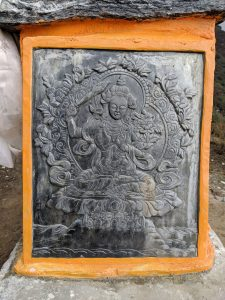 Carved panels along the trail