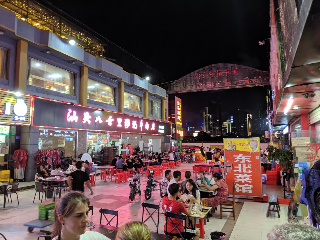 "A typical open-air food court where you can get ""chicken on a stick"""