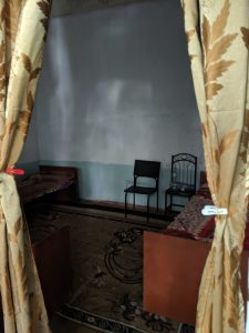 Room with two beds and two chairs