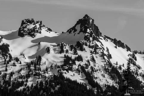 A black and white photograph of Pinnacle Peak on a sunny early Spring day as viewed from the Paradise area of Mount Rainier National Park, Washington.