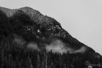 A black and white landscape photograph of the shoulder of Tirzah Peak as vieweed from the Carbon River Valley at Mount Rainier National Park, Washington.