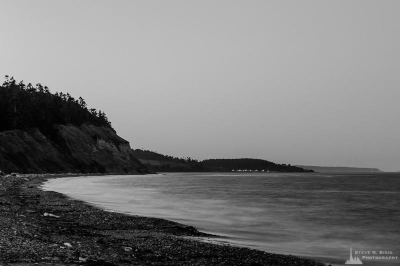 A black and white, long exposure photograph of the shoreline of Ebey's Landing on Whidbey Island near Coupeville, Washington before first light on a clear August morning.
