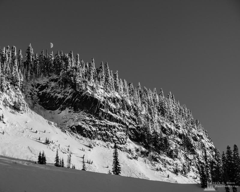 A black and white landscape photograph of a snow covered Inspiration Point at Mount Rainier National Park, Washington.
