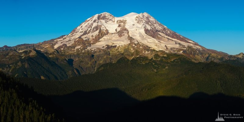 An early fall  panoramic landscape photograph of Mount Rainier as viewed from the Glacier View Lookout near Ashford, Washington.