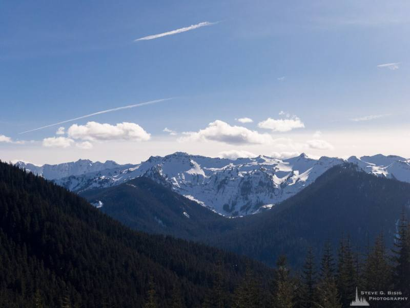 A mobile landscape photograph of the Clear Fork Cowlitz River valley and the surrounding snow covered Coyote Ridge in the Goat Rocks Wilderness Area as viewed from Gifford Pinchot National Forest Road 1284 in Lewis County, Washington.