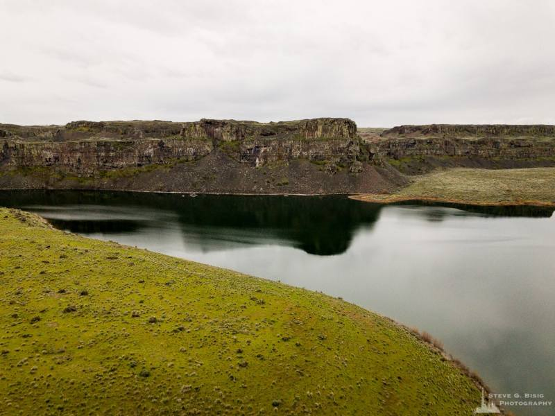 A mobile photograph of Dusty Lake as seen high from a saddle above the Potholes Coulee in the Quincy Lakes Unit of the Columbia Basin Wildlife Area in Grant County, Washington.