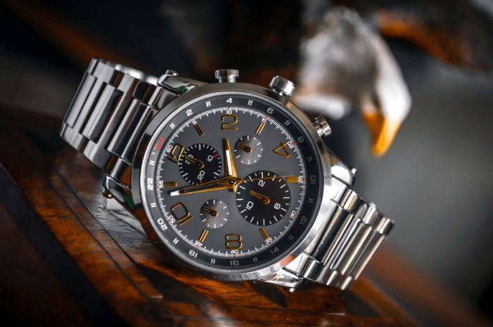 slivel wristwatch with golden ornaments