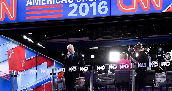 UNITED STATES - JULY 28: CNN's Anderson Cooper looks out over the floor form the CNN booth at the Democratic National Convention in Philadelphia on Thursday, July 28, 2016. (Photo By Bill Clark/CQ Roll Call)