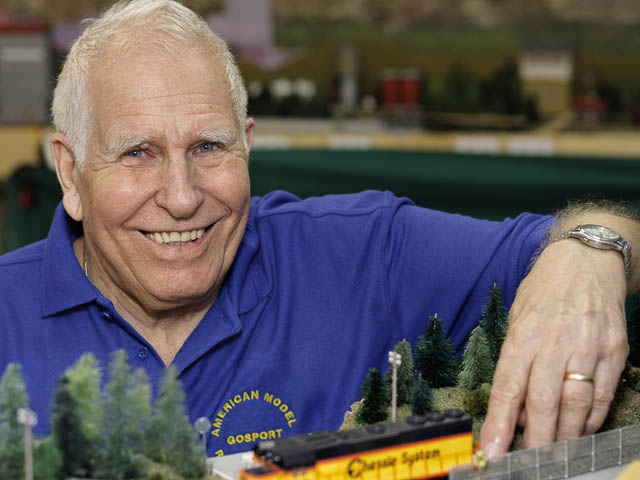 Model Railway Enthusiast Portrait With American Rolling Stock And Layout