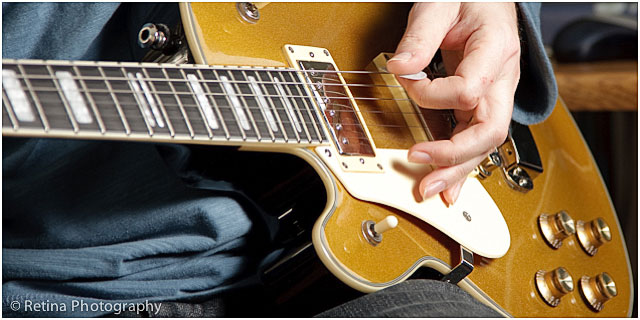 Close Up Of Guitarist Hand Playing Yellow Electric Guitar