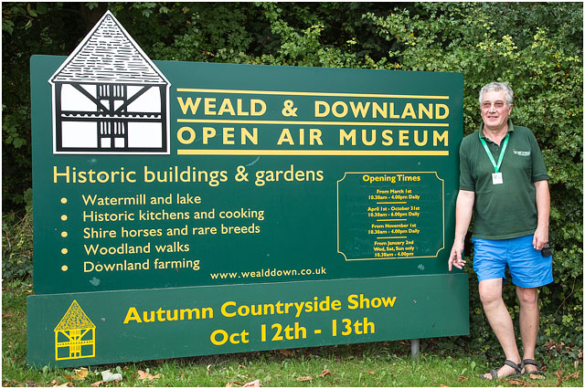 Weald And Downland Open Air Museum Entrance Sign With Volunteer Worker