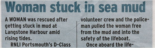 Woman Stuck In Mud Newspaper Clipping