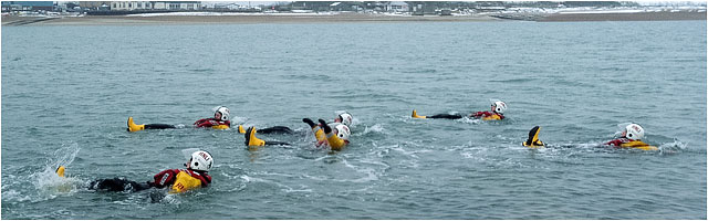 RNLI Volunteer Crew Testing Survival Kit In Cold Water