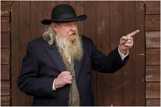 Portrait Of Wild West Preacher Dressed In Black And Pointing
