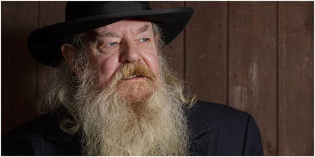 Portrait Of Wild West Preacher With Black Hat And White Bushy Beard