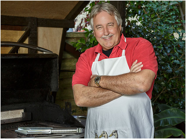Man Folded Arms Red Polo Shirt White Cooking Apron BBQ Smiling