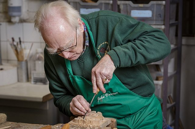 John Vardon secretary of the solent guild of woodcarvers and sculptors at a carve-in day