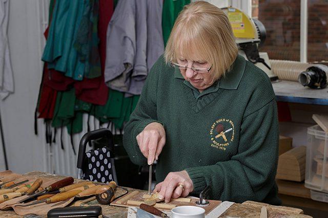 female woodcarver