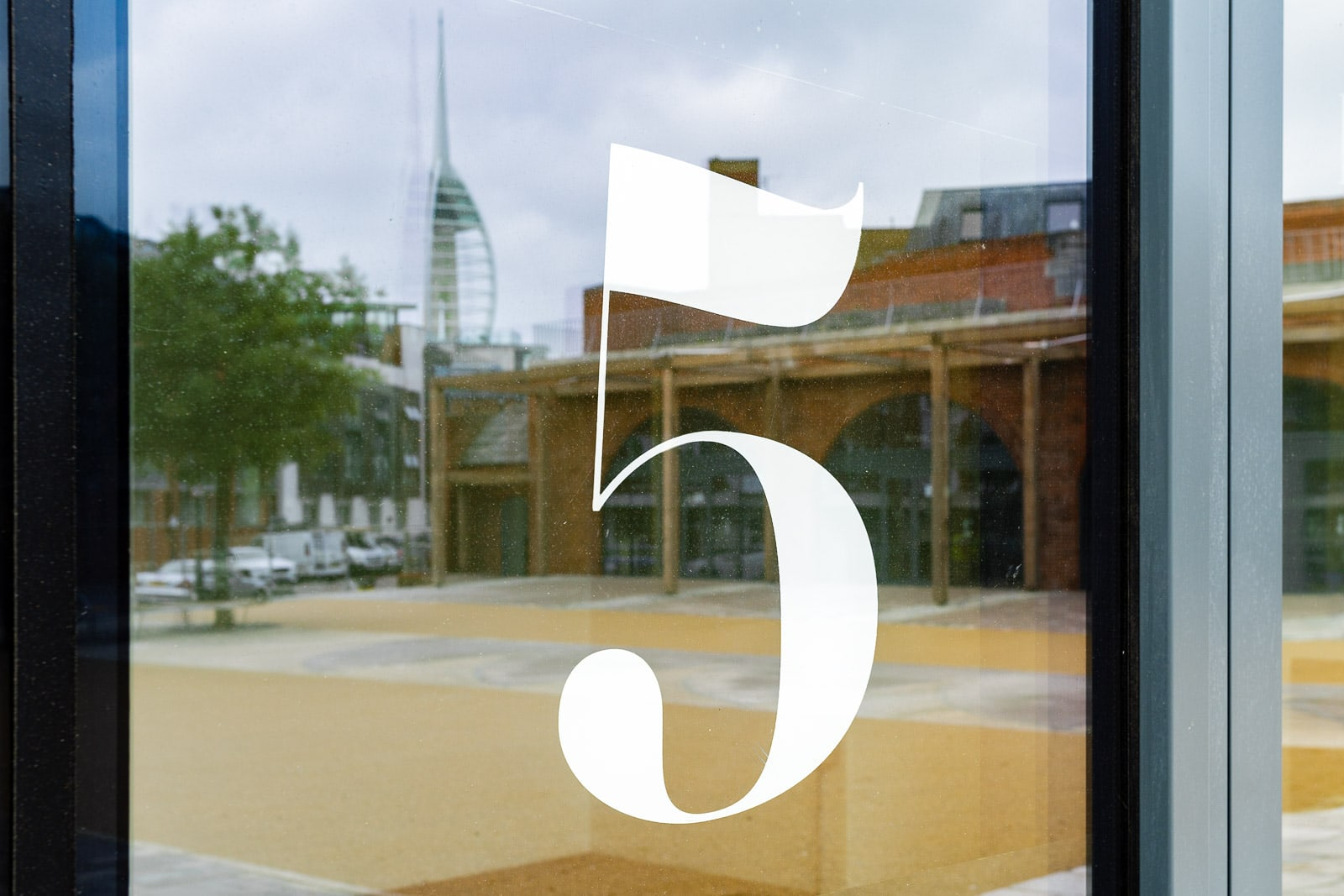 Interior view looking out from artists studio to portsmouth hot walls area featuring the number five on the door