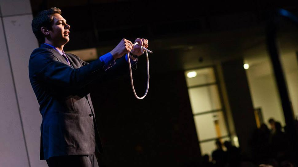 Magician Steven Brundage performing rope magic at a corporate event
