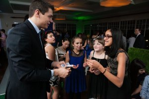 Magician Steven Brundage performing card tricks at a private event