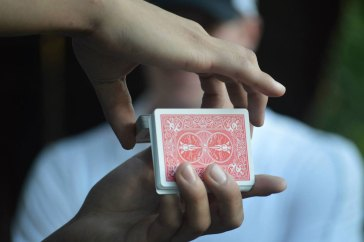 Magician Steven Brundage performing card tricks