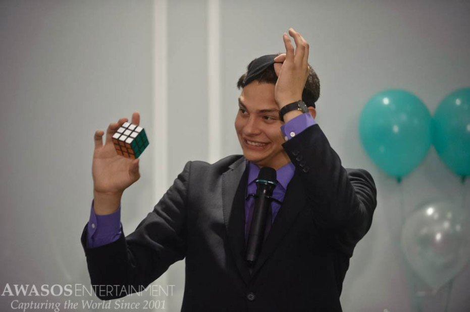 Magician Steven Brundage solves a Rubik's Cube while blindfolded