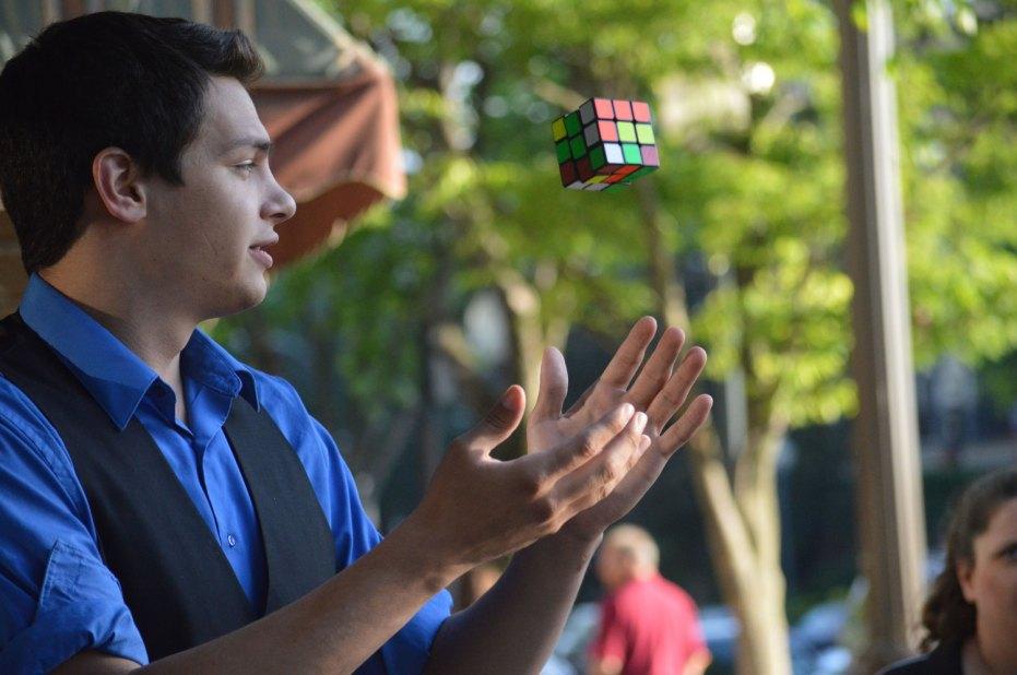 Magician Steven Brundage performing Rubik's Cube Magic