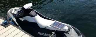 jet ski charging battery with solar panel while in the water