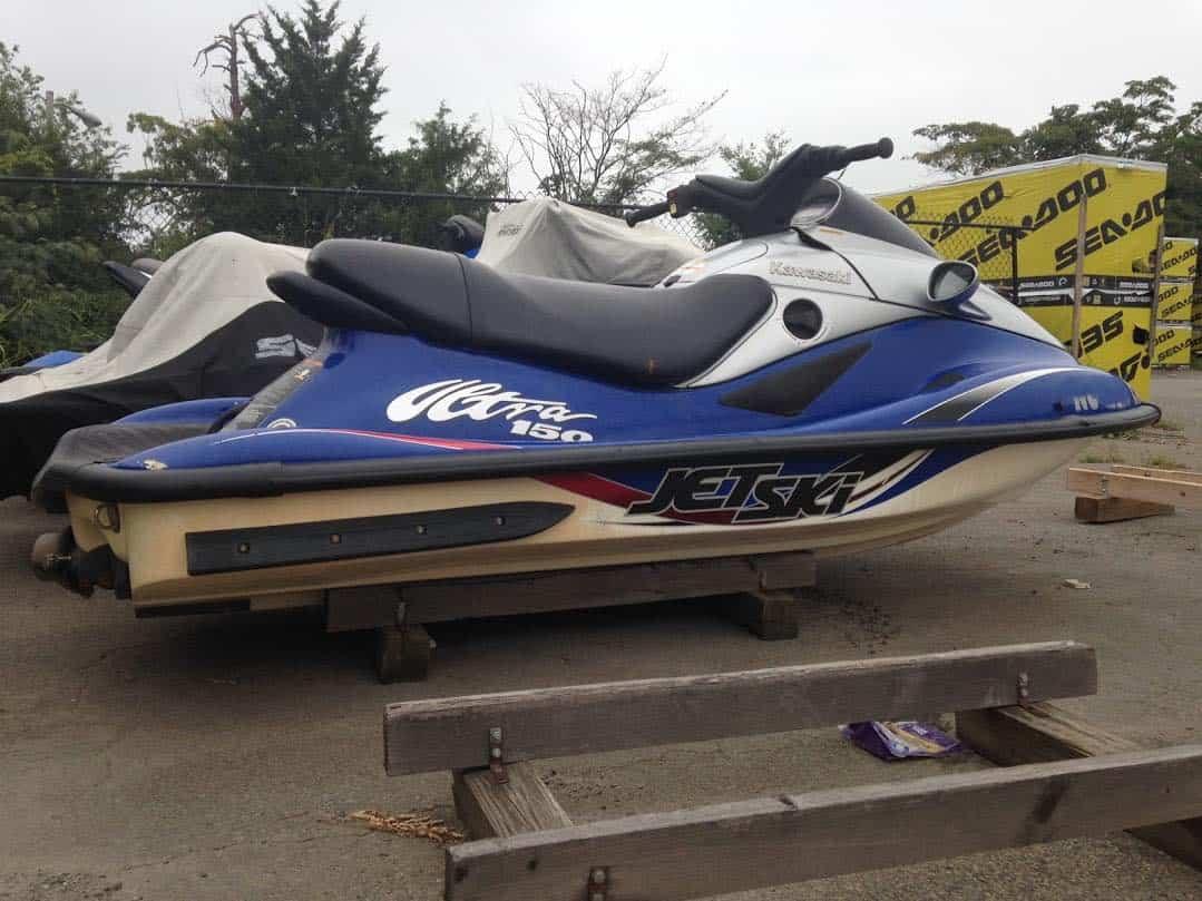 motorcycle with Ratchet Jet Logic Powerspor Tiedown Strap docking jetski