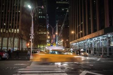 A New York Taxi-cab Speeds Across a Pedestrian Crossing