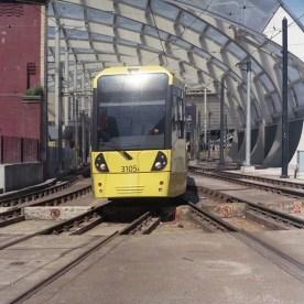 A Tram departs Manchester Victoria bound for Market Street