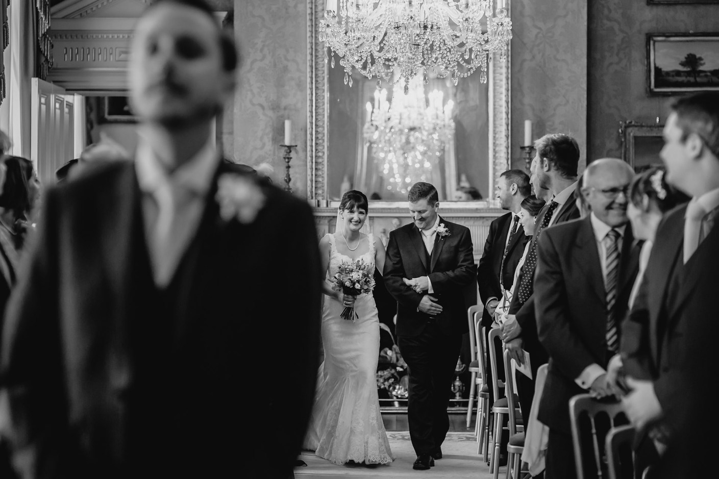 here ceomes the bride - photo down the aisle before the service in cheshire
