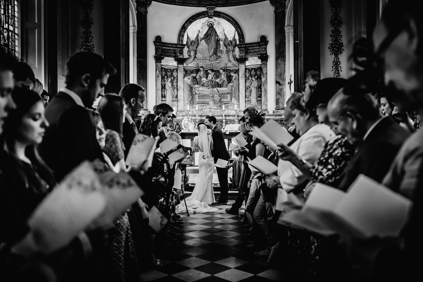 photo of jess and phil in the chapel, capesthorne hall wedding photographer