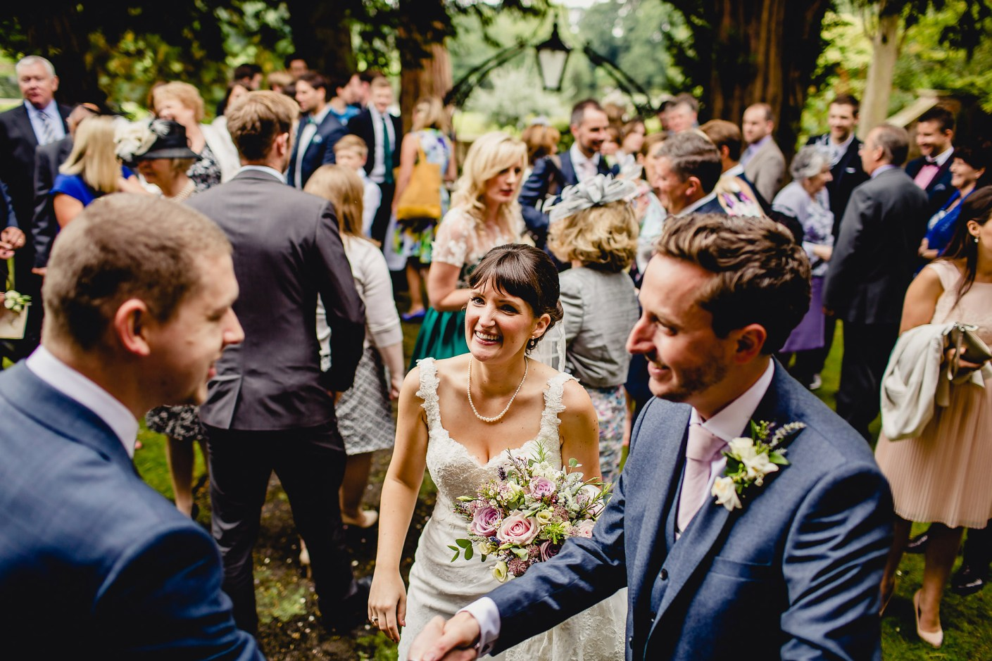 greeting guests after the blessing - capesthorne hall wedding
