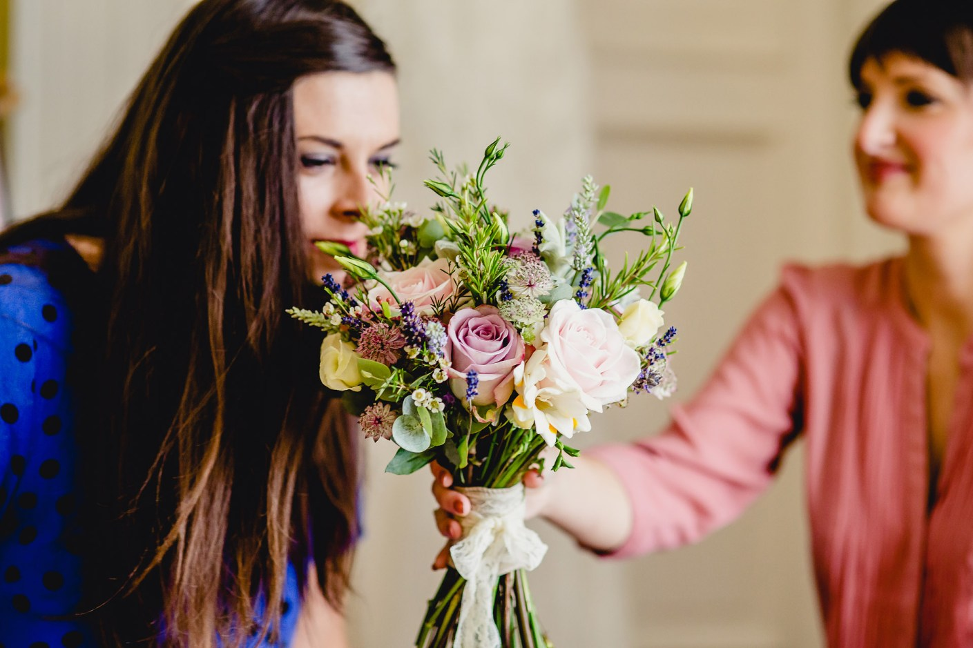 photographs of the bridesmaid smelling the boquet