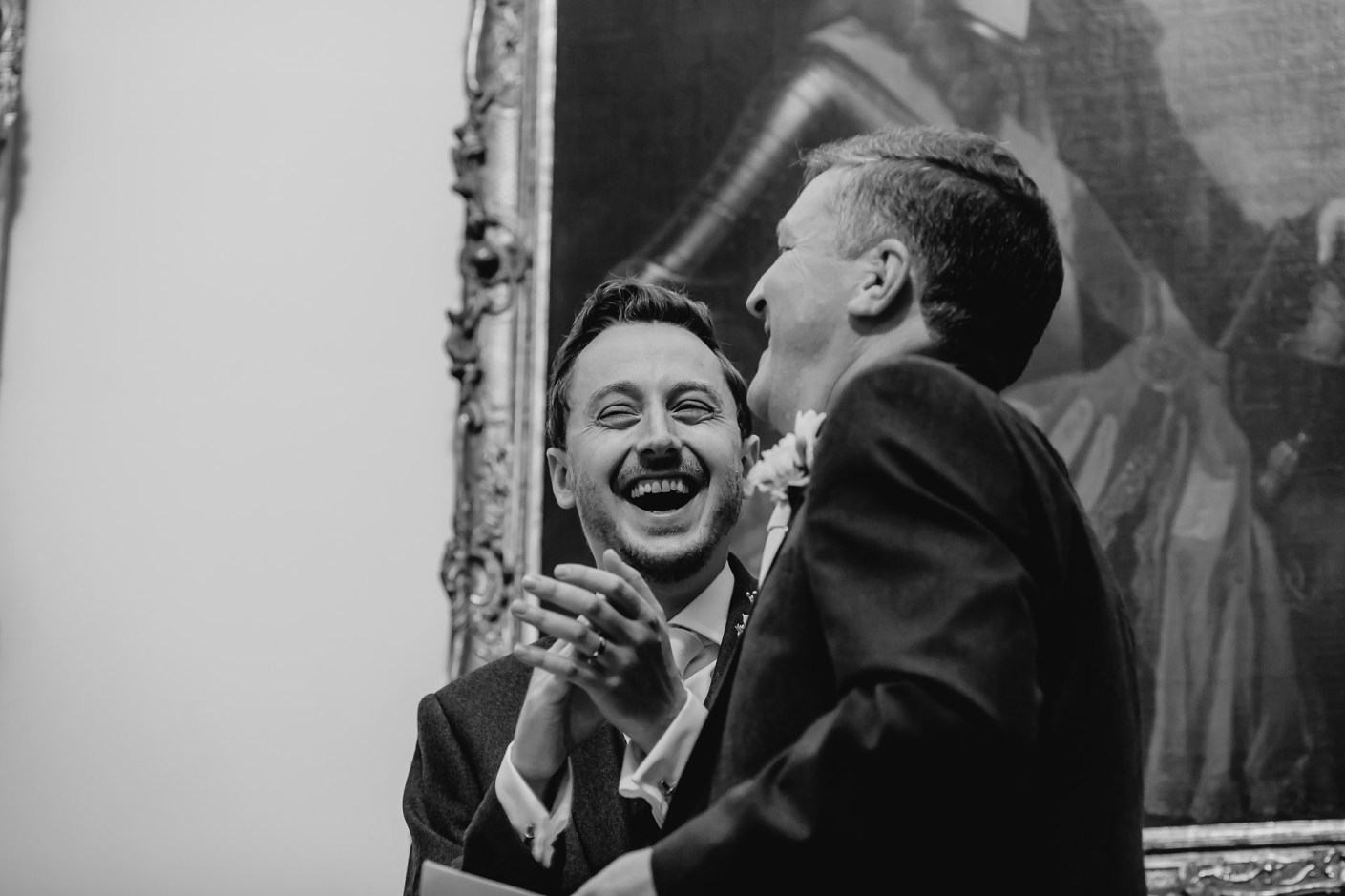 phil laughing with jess dad during the speeches