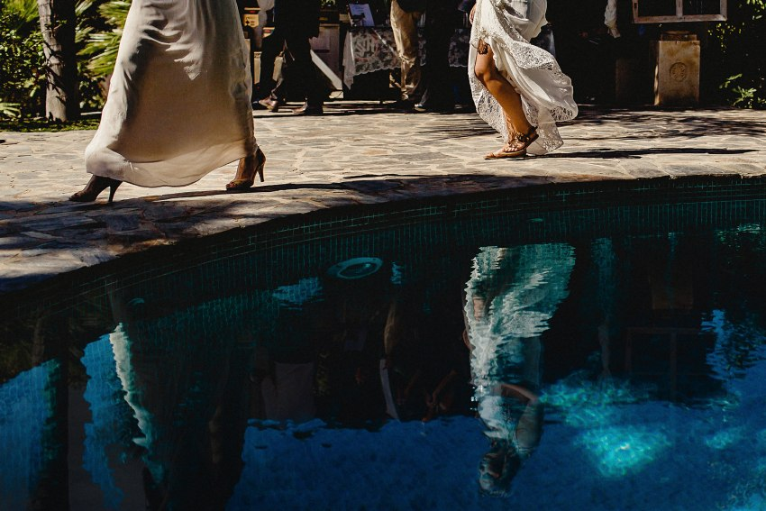 reflection of the bride in the swimming pool
