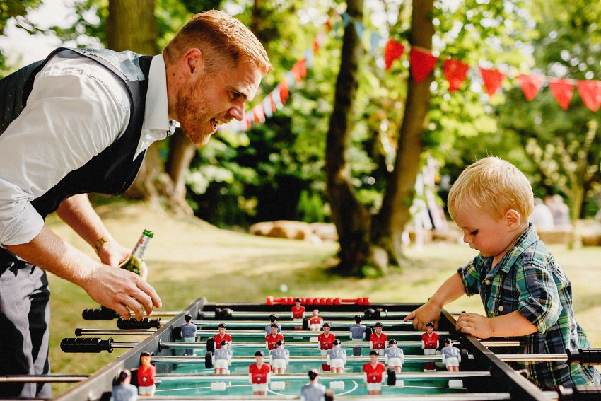 father and son playing table football