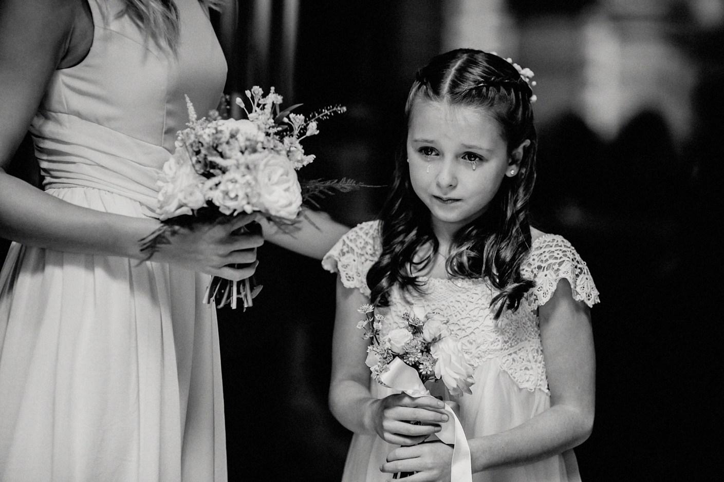 young bridesmaid crying