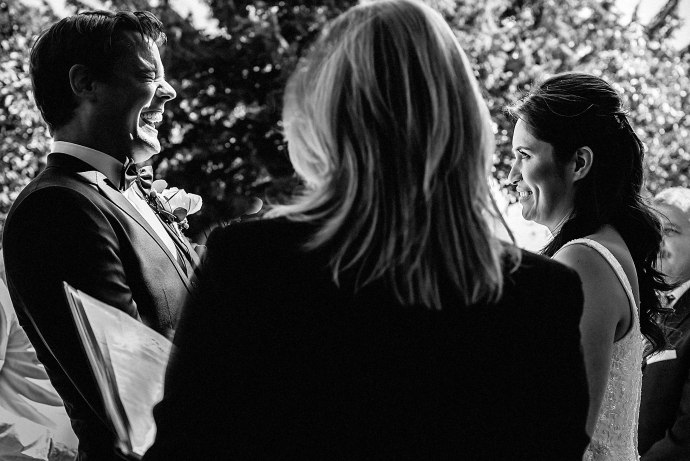 groom laughing during the nuptials