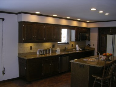refurbished kitchen cabinetry along with an new kitchen island