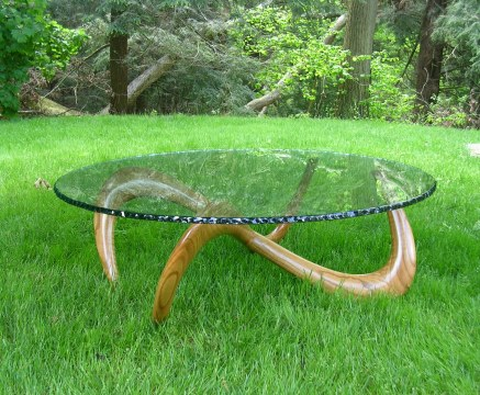 "Infinity table made from curly red oak with ""bark"" edging to the glass that is also polished"