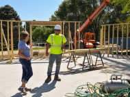 Board member, Judi Carr, talks with a worker on the project