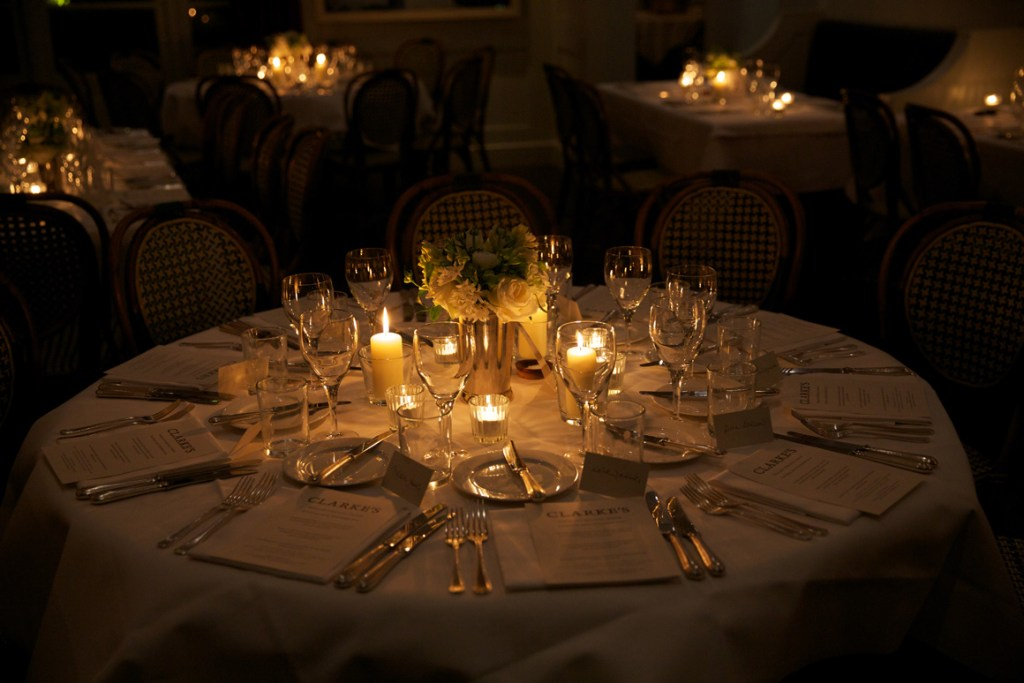60th Birthday candle lit table setting at Sally Clarke Restaurant
