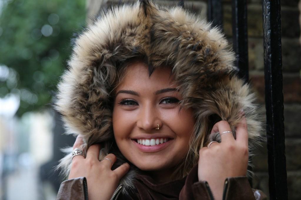 Eli Rose, singer wearing a fur and velvet hood by Polly Rutland.