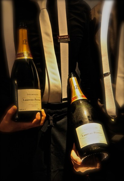 Waiters with chilled champagne bottles